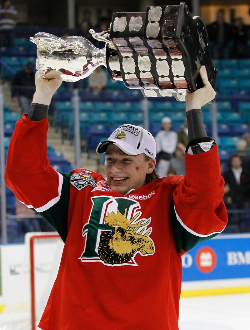 Austyn Hardie of the Halifax Mooseheads with the Memorial Cup after defeating the Portland Winterhawks , in the final of the 2013 Mastercard Memorial Cup at the Credit Union Centre on May 26, 2013 in Saskatoon, Saskatchewan. Al Charest/Calgary Sun/QMI Agency